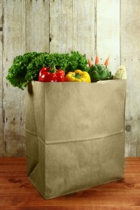 5571087-bag-of-grocery-produce-items-on-a-wooden-plank